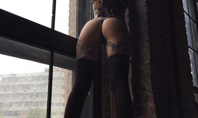 Cover for backstage post Tattoos on her thighs that rock ;)